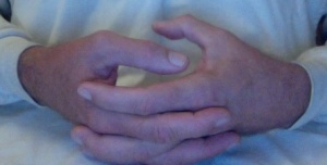 twiddling thumbs